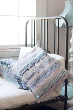 pillows made from rag rugs ::: You could make small (new) rag rugs and then make the pillows. Great for floor pillows. Lorr