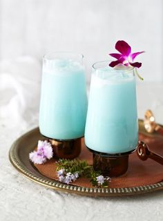 Tropical cocktail made of rum, pineapple juice, curacao, coconut and vodka