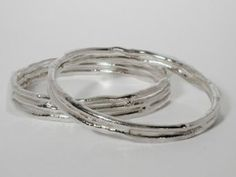 Silver 'Cyclone' bangles from £175 Designed & Made by Jane Watling