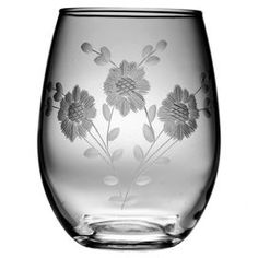 Set of four stemless wine glasses with hand-cut floral detail.