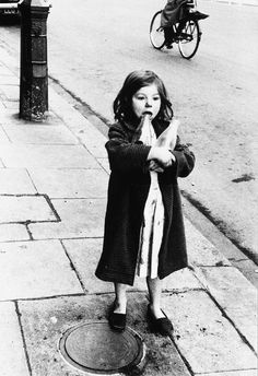 Girl and milk bottles, Princedale Rd., North Kensington, London. 1957, Roger Mayne. English, born in 1929.