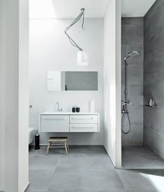 The family shares one main bathroom, which is outfitted with Vipp's new line of products: 982 bath furniture, a 906 faucet, and a 992 mirror. The shower sports a Raindance Connect showerhead by Hansgrohe, and there is a wall-mounted toilet by Villeroy & Boch. The Nomad light fixture is from Modular Lighting Instruments, and the floors are topped with ceramic tiles by LaFaenza. photos by: Anders Hviid