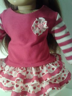 - like the different fabric for sleeves and little flower