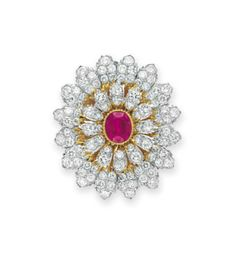 A DIAMOND AND RUBY BROOCH, BY BUCCELLATI   Set with a bezel-set oval-cut ruby, within a circular-cut diamond and sculpted 18k gold surround, mounted in 18k yellow and white gold, in a Buccellati gray leather case  Signed Buccellati, Italy