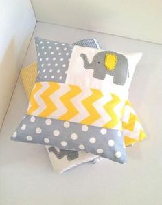 Love the patterns, but would like Gray and baby blue. Elephant Baby Crib Quilt and Pillow in Yellow and Gray.