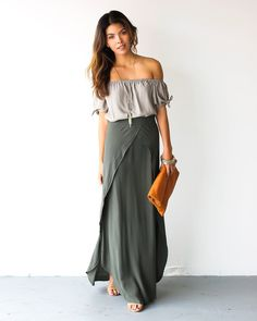 Our Leeta Maxi Skirt takes our breath away with every step! A beautifully olive hued maxi skirt with intricate and unique draping in the front and side slits fo