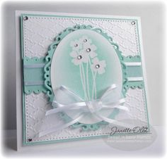 mint green and white stamped, ribbon, die cut, and embossing folder card