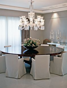 Dining Room - Round table with comfortable dining chairs and a crystal chandelier....love the round table!