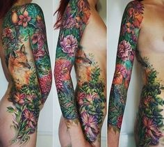 elaborate nature tattoo with flowers, leaves and a fox