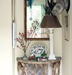 Small cottage entryway with mercury glass mirror and a French oplaline glass pendant lamp