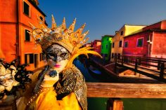 Photo taken on a bridge on Burano Island during Venice, Italy Carnival.  - image by Ken Koskela