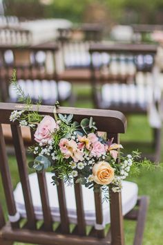 Such a cute idea for the back of the isle chairs. :)