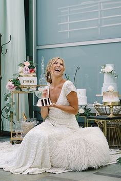 Bride Laughing Alone with Cake | John Schnack Photography | http://heyweddinglady.com/succulents-sparkles-stripes-modern-socal-wedding/