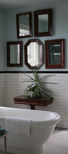 A cohesive collection of vintage mirrors in a bathroom at the P.Allen Smith house - from The Rainforest Garden blog
