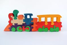 Wooden Puzzle Train Toy, Natural Organic Eco Friendly Waldorf Education Children Baby Kids Game by WoodlandToy on Etsy https://www.etsy.com/listing/209711470/wooden-puzzle-train-toy-natural-organic