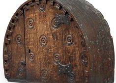 Charles II small boarded oak mural cupboard, Welsh Borders, circa 1660 - 80, the front boards and single-door decorated with multiple concentric roundels or draughts. Sold at Bonhams for £15k