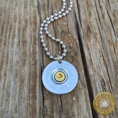 Unisex 20 gauge shotgun shell necklace in brass or nickel with a 24 inch ball chain *due to varying inventory, manufacturer lettering on bullet casings may not be same as pictured