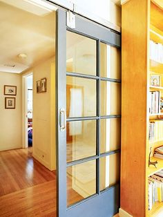 """Sliding French """"barn door"""", slides behind a shelf so no wasted wall space"""