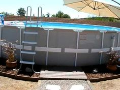 Intex 24 foot metal frame pool with Intex Salt Water System. I installed landscaping bender board around the pool and filled it with wood chips, added a few . Intex Above Ground Pools, Above Ground Pool Landscaping, Backyard Pool Landscaping, In Ground Pools, Landscaping Ideas, Oberirdische Pools, Cool Pools, Swimming Pools, Mini Pool