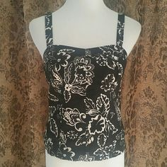 NWT ANN TAYLOR BUSTIER TOP Show some skin in this gorgeous blouse or layer a jacket/kimono over it!  * Tank style straps * Black shell w/ivory floral design * Fully lined  * Stretch panel in back  * Pullover style  * Linen - Machine washable  * Bust darts and seaming in all the right places * Feel free to ask for measurements  * This item will be cross listed   Reasonable offers always considered. Over 150 items listed so take a look and bundle to save more! Ann Taylor Tops