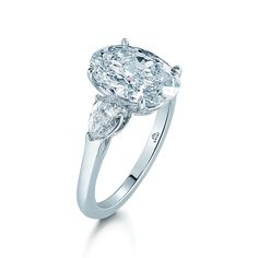 Oval Diamond and Platinum Ring with Two Pear Shapes