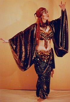 Black and bronze costume by Tahia Alibeck