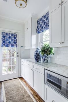 white and marble kitchen with bright blue accents