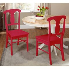 The rich red finish and timeless design of the empire chair will brighten up any dining space. Featuring an urn-back design and curved front legs that make this set of chairs stand out from the rest.