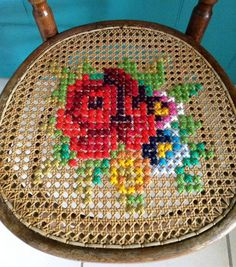 Amazing idea to cross stitch caned chairs!