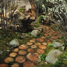 A walkway made of wood slices is delightfully earthy and rustic. Just lay your slices out on a bed of sand and let nature take its course. With moss growing between the wood, it feels ancient and other-worldly.