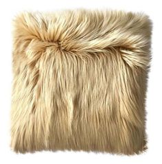 Caramel fur pillow: http://www.stylemepretty.com/living/2016/02/25/steal-these-hollywood-home-looks-for-a-fraction-of-the-cost/