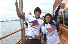 """This is the handsome Xian Lim and the pretty Kim Chiu smiling for the camera with Filipino-Americans riding on a ferry in New York City, New York, U.S.A. during the taping of the ABS-CBN 2016 Summer Station ID and Halalan 2016 Station ID theme song, """"Ipanalo ang Pamilyang Pilipino!"""" #IpanaloangPamilyangPilipino #XianLim #KimChiu #ChinitaPrincess #KimXi #TheStoryofUs"""