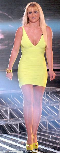 f4da571b932fba Britney Spears transforms from scruffy and casual to a neon vision in  form-fitting bandage dress at X Factor semi-final