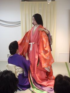 A woman dressed in junihitoe layer by layer at a kimono demonstration