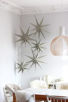 Yule style!! Noel Christmas Winter Solstice!! folding white paper stars that look like snowflakes - Ikea? White Christmas!