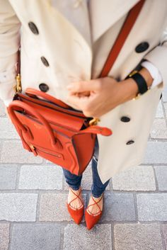 We're loving these red lace-up flats and red bag with a tan coat and jeans.