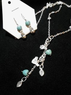 Silver bird and turquoise hearts long pendant set