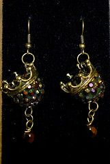 Bronze crowns, sparkly beads earrings