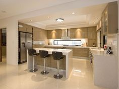 Modern open plan kitchen design using polished concrete.  Love the thick counters and wine storage