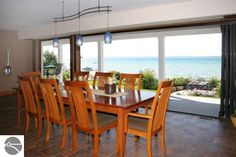 West and Northern Michigan real estate and homes for sale. Charlevoix, Petoskey, Grand Rapids, Kalamazoo and Gaylord area real estate and homes for sale. Outdoor Tables, Outdoor Decor, Traverse City, Lake Michigan, Floor Plans, Real Estate, Outdoor Furniture, Flooring, Dinner