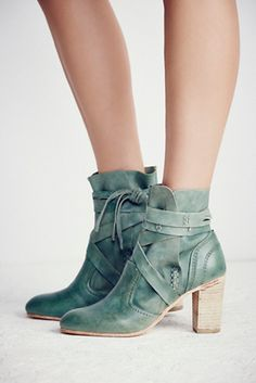 Seven Wonders Heel Boot   Free People Washed leather rounded toe ankle boot featuring a wrap tie with fringe detailing.
