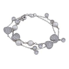 "Rhodium Plated Sterling Silver White Shell Pearl and Cubic Zirconia Double Layered Heart and Bead Shaped Bracelet, 7.5"" Amazon Curated Collection. $89.00. Made in China"