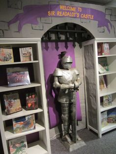 Our Scholastic Book Fair Fall 2014 entry way to Sir Readalot's Castle is guarded by a knight in shining armor.