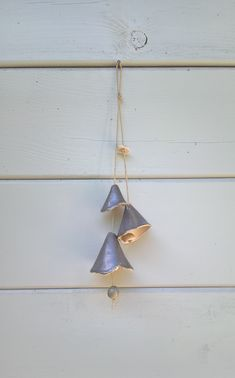 Handmade ceramic bells made of beige clay with a matt greenish grey glaze. Indoor and outdoor decoration. Ceramic Clay, Ceramic Pottery, Christmas Clay, Porcelain Jewelry, Handmade Ceramic, Clay Projects, Wind Chimes, Beige, Mobiles