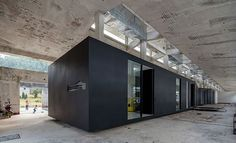 iD Town by O-Office. Guangzhou-based O-Office architects just recently opened up the first exhibition in iD town, an ongoing project, built within an abandoned, decades-old factory.: