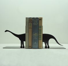 Brontosaurus Metal Art Bookends - Free USA Shipping. $46.99, via Etsy.  Um, could I DIY this?  Let's find out.