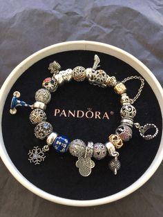 My Disney pandora bracelet. Need to buy the Disney exclusive bracelet.