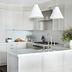 White and Gray Kitchen with Farmhouse Sink in Peninsula