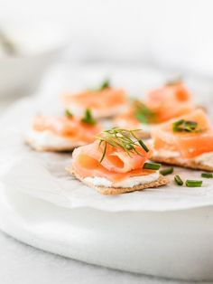 These delicious 5 Ingredient Smoked Salmon Bites are easy to make for your next party, and taste amazing! Your guests will love these crackers topped with a flavorful garlic herb spread and smoked salmon. Easy 5, Smoked Salmon, Fresh Herbs, Fruit, Party, Food, Essen, Parties, Meals