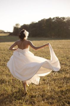 this would be even better if the groom was standing in the background & she was running to him!